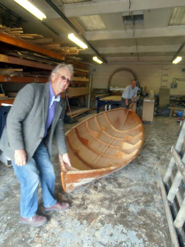 The delivery team take a look at a Wemyss skiff under construction