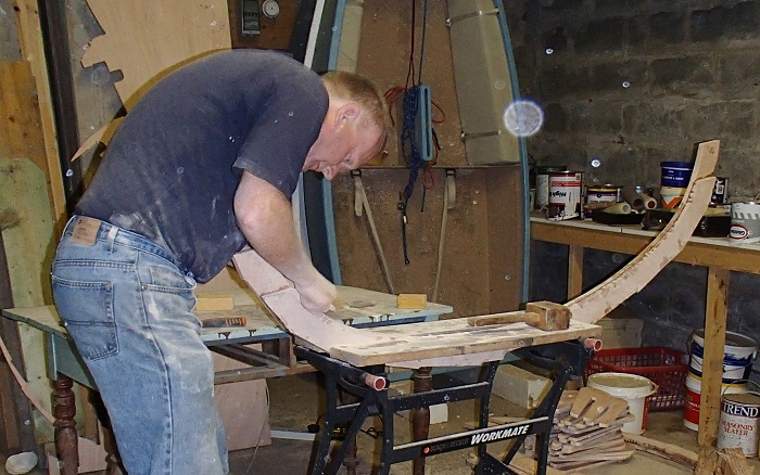 Cleaning up the epoxied frames - these are what the planks attach to.